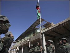 Afghan troops raise flag in Marjah, 17 Feb
