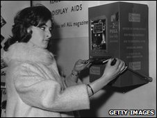 Woman buying a Reader's Digest from a vending machine in 1961