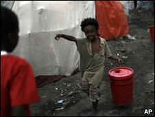 Girl carries water in Port-au-Prince, 17 Feb
