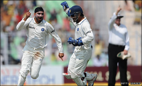 Harbhajan Singh (left) celebrates with captain Mahendra Dhoni
