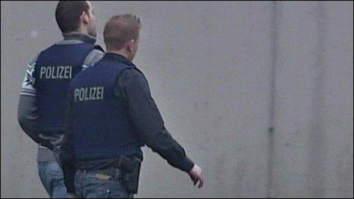 German police officers at school