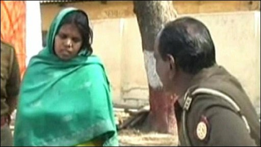 Indian woman being spoken to by police officer