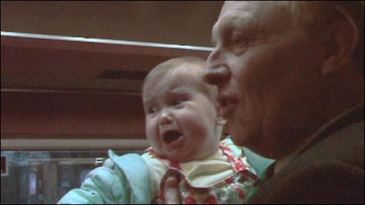Neil Kinnock on the campaign trail with a baby