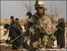 A US soldier and Afghan civilians on outskirts of Marjah - 18 February 2010
