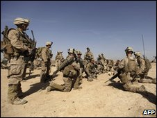 US marines with 1/3 marine Charlie Company kneel and pray before going on patrol in Trikh Nawar - 18 Feb 2010