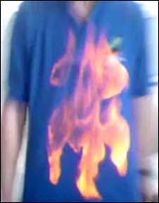 You Tube still of boy setting his clothes on fire