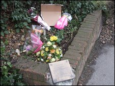 Cardboard sign at memorial site (picture courtesy of Newsquest London Ltd)