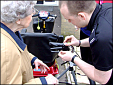 Pc Dave Castree fits a wheelchair alarm