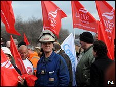 Steelworkers and their families gather outside the Corus steelworks in Redcar