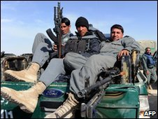Afghan police in Camp Bastion wait to depart for Marjah on 19 February 2010