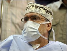 Abdelbaset Ali Mohmed Al Megrahi wearing medical mask at a hospital in Tripoli
