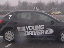 A youngster takes driving lessons