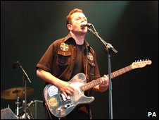 Joe Strummer and the Mescaleros performing in 2002