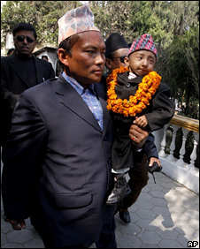 Khagendra Thapa Magar is carried by his father (21 February 2010)