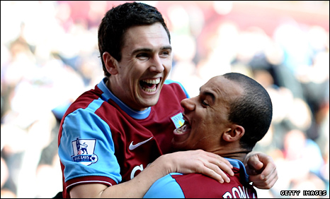 Stewart Downing and Gabriel Agbonlahor celebrate Villa's second goal
