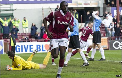 David Obua celebrates scoring a goal for Hearts against Hamilton