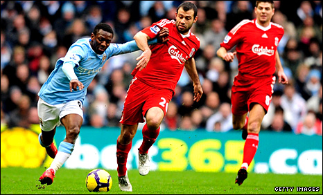 Shaun Wright-Phillips holds off the challenge of Javier Mascherano
