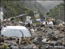 A destroyed car is pictured near Ribeira Brava, Madeira Island, on February 21, 2010