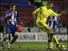 Peter Crouch controls the ball