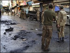Pakistan army soldiers cordon off the blast site in Mingora, capital of Pakistan's troubled Swat Valley, Monday, Feb. 22, 2010.
