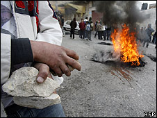 Palestinian holding rocks during rioting in Hebron (22.02.10)