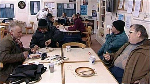 Men eating in cafeteria