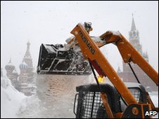 A tractor clears snow on Red Square, 22 February