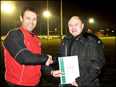 Brian Moore (right) receives his certificate as a qualified referee