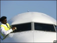 Man polishing the window of an aircraft
