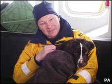 Volunteer lifeboat crew member Gavin Butcher with Poppy