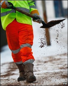 Council worker shovelling grit - generic