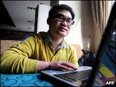A Beijing office worker surfs the internet