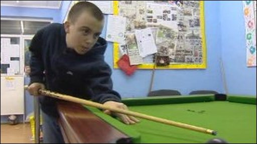 Boy playing snooker