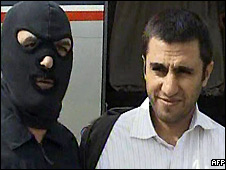 Abdolmalek Rigi under arrest at a Tehran airport