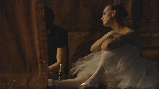 A ballerina from the Bolshoi ballet and opera company watches rehearsals from the sidelines