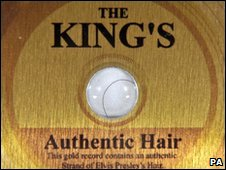 Strand of Elvis Presley's hair in a gold disc