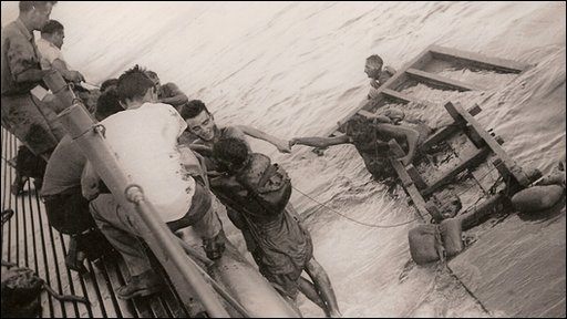 Survivors from the Kachidoki Maru being rescued by US sailors