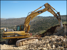 Diggers in the Rawabi hills