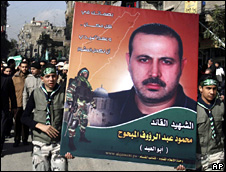 Hamas supporters carry a poster of Mahmoud al-Mabhouh