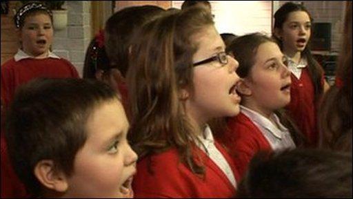 Schoolkids sing for Haiti