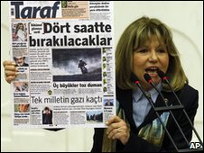 Republican People's Party lawmaker Nur Serter shows a copy of Taraf in parliament, Ankara, 25 February 2010