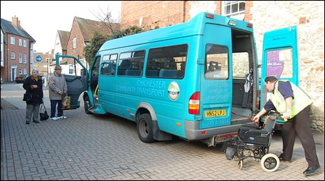 A blue minibus and its driver