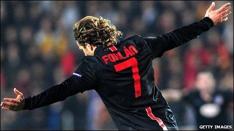 Diego Forlan celebrates