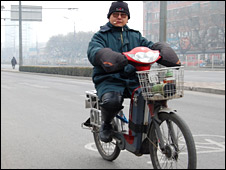 Man riding an electric bike in Beijing