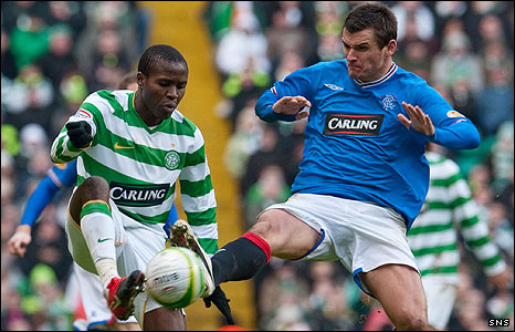 Landry N'Guemo and Lee McCulloch challenge for possession
