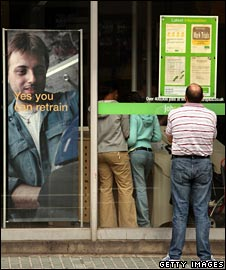 Man looks at Jobcentre Plus vacancies