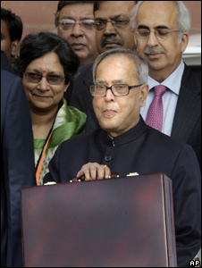 Finance Minister Pranab Mukherjee shows off a briefcase containing Budget documents in Delhi on 26 Feb 2010.