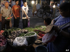 People buying vegetables in India