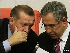 Turkish Prime Minister Recep Tayyip Erdogan (L) talks to his deputy Bulent Arinc in parliament, Ankara, 25 February 2010