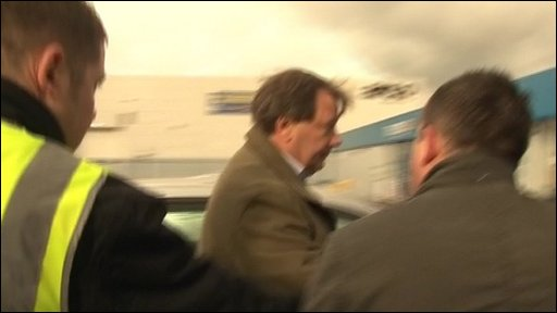 Peter Storrie arrives at Fratton Park
